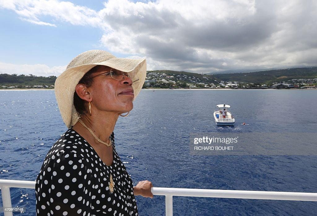 French Overseas Territories minister <a gi-track='captionPersonalityLinkClicked' href=/galleries/search?phrase=George+Pau-Langevin&family=editorial&specificpeople=4313353 ng-click='$event.stopPropagation()'>George Pau-Langevin</a> is pictured on a boat on April 24, 2014 off les Roches Noires beach, western coast of the French Indian Ocean island of La Reunion, during a presentation of the water protection plan, 12 days after a shark attacked and killed a 13-year-old boy as he was surfing in the area. Paul-Langevin announced on April 24 that the hunting of tiger sharks and bull sharks will be allowed in the Marine wildlife sanctuary of La Reunion to reduce risk of sharck attacks. AFP PHOTO / RICHARD BOUHET