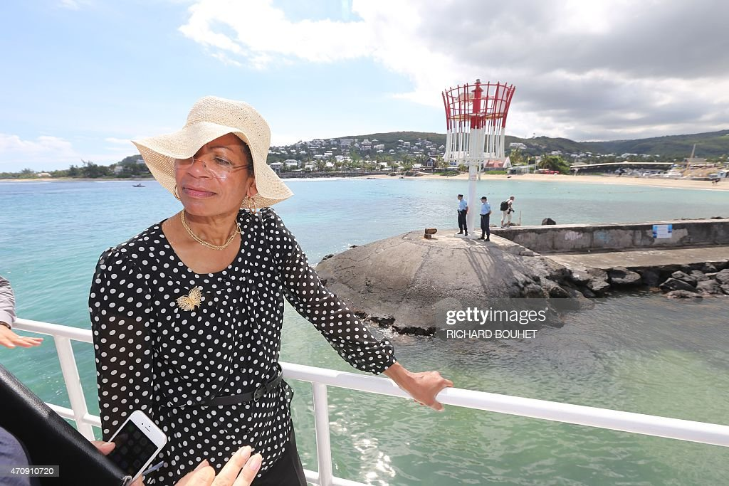 French Overseas Territories minister <a gi-track='captionPersonalityLinkClicked' href=/galleries/search?phrase=George+Pau-Langevin&family=editorial&specificpeople=4313353 ng-click='$event.stopPropagation()'>George Pau-Langevin</a> speaks to journalists on a boat on April 24, 2014 off les Roches Noires beach, western coast of the French Indian Ocean island of La Reunion, during a presentation of the water protection plan, 12 days after a shark attacked and killed a 13-year-old boy as he was surfing in the area. Paul-Langevin announced on April 24 that the hunting of tiger sharks and bull sharks will be allowed in the Marine wildlife sanctuary of La Reunion to reduce risk of sharck attacks. AFP PHOTO / RICHARD BOUHET
