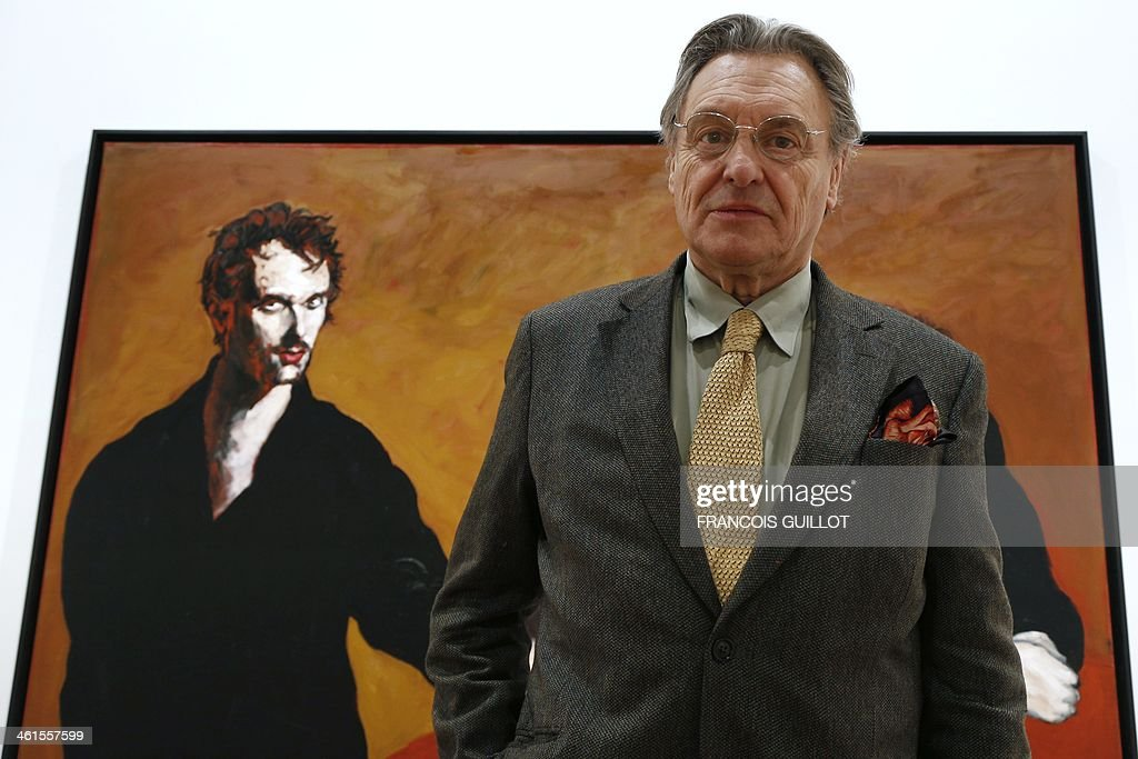 French painter Gerard Garouste poses in front of one of his works, on January 9, 2014 in Paris, prior to a new exhibition organized at the Templon Galerie from January 11 to February 26. AFP PHOTO FRANCOIS GUILLOT CAPTION