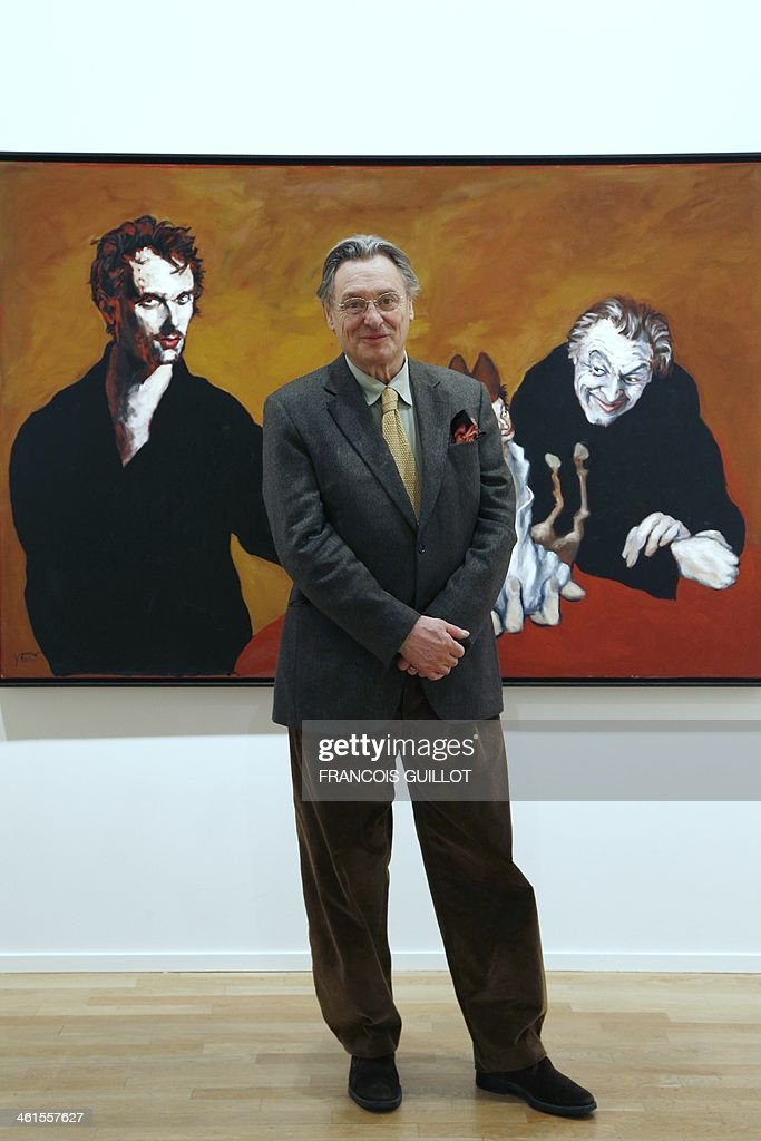 French painter Gerard Garouste poses in front of one of his works, on January 9, 2014 in Paris, prior to a new exhibition organized at the Templon Galerie from January 11 to February 26.
