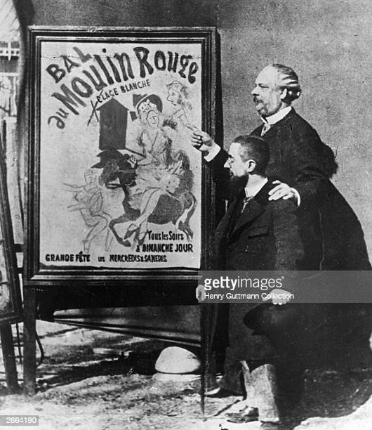 French painter Henri ToulouseLautrec standing with the Director of the Moulin Rouge Tremolada by one of his painted posters advertising the famous...