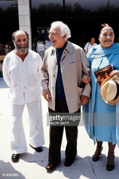 French painter Marc Chagall the day of his 92th birthday leaves the Marc Chagall museum accompanied by his wife Valentina Brodsky and french sculptor...