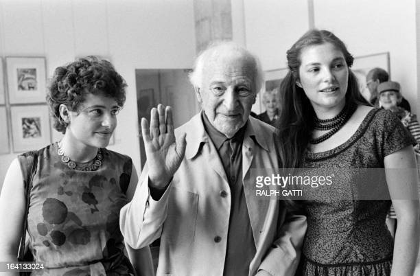 French painter Marc Chagall today celebrating his 92 birthday visits Chagall's museum by his little girls Merett and Bella in Nice on July 7 1979 AFP...