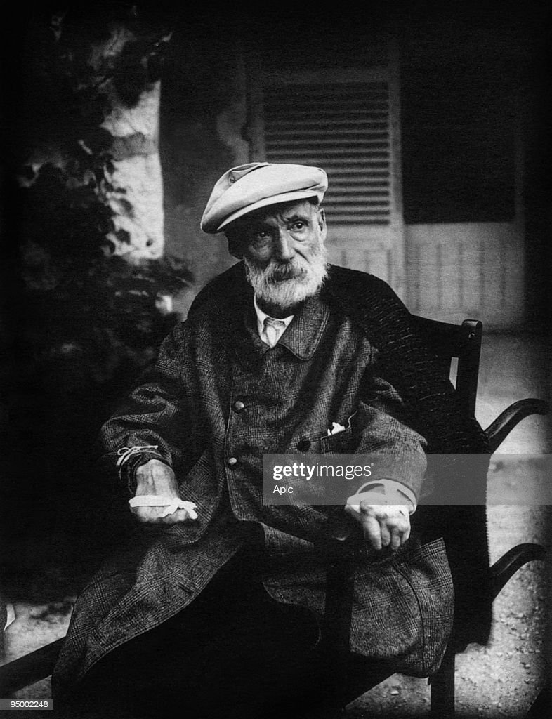 French painter Pierre <a gi-track='captionPersonalityLinkClicked' href=/galleries/search?phrase=Auguste+Renoir&family=editorial&specificpeople=117768 ng-click='$event.stopPropagation()'>Auguste Renoir</a> (1841-1919) c. 1918 showing his arthritis and the tape he used to strap his brush to his hand