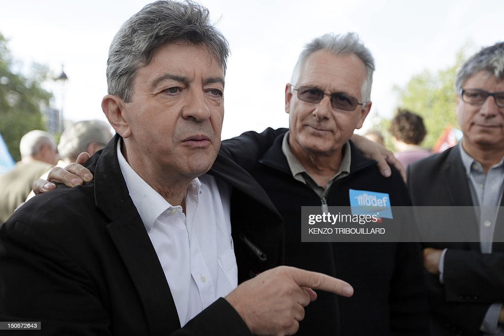 French Parti de Gauche (PG) leader Jean-Luc Melenchon (L) speaks next to Raymond Girardi, general secretary of the farmer trade union Modef, on August 22, 2012 at the Place de la Bastille in Paris during a sale of fruits and vegetables organised by the communist party and the Modef. Trade Union Confederation agricultural family farmers (Modef) organized in Paris and 27 suburbs a sale 'at the right price' of 40 tons of fruits and vegetables from the Lot-et-Garonne to denounce ' unreasonable margins' of supermarkets.