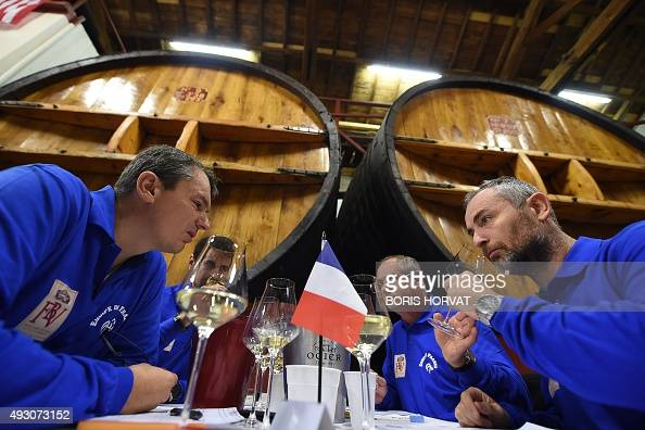 French participants taste white wine on October 17 during the Blinded World Championships of Wine waiters with 80 participants representing 20...