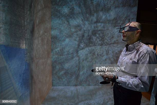 French patient Denis Duet wearing a virtual reality headset undergoes a VR therapy session called 'CtrlStress' at the laboratory of the Institut des...