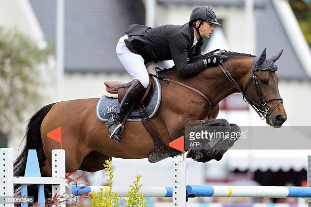 French Patrice Delaveau riding Orient Express Hdc competes during the International jumping of France on May 19 2013 in La BauleEscoublac western...