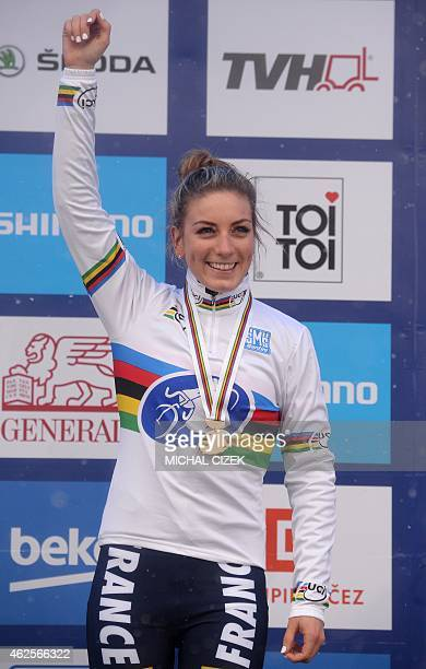 French Pauline Ferrand Prevot celebrates on the podium after winning the women's race at the UCI World cyclocross World championships on January 31...