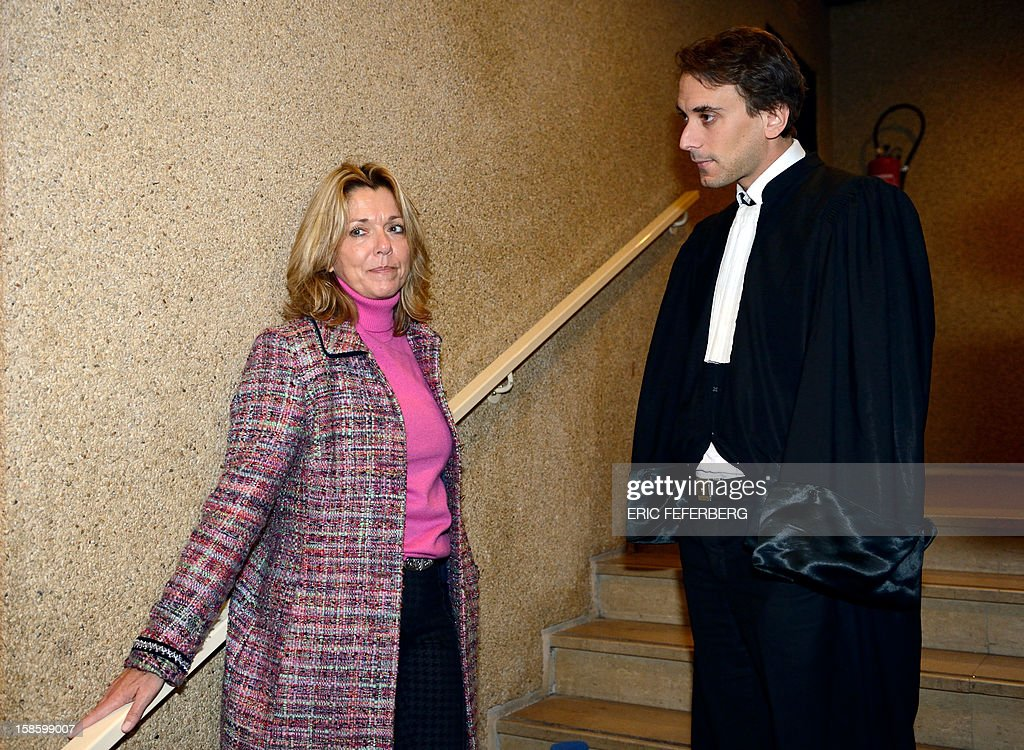 French Philippe Ohayon (R), lawyer of Dieter Krombach, accused of the killing, 30 years ago, of his daughter-in-law, Kalinka Bamberski, speaks with his daughter Diana Krombach, on December 20, 2012, on the sidelines of the trial at the criminal court in Creteil, a Paris suburb.The prosecution had requested 15 years of imprisonment on October 21, 2011.