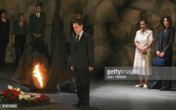 French philosopher and Holocaust survivor Simone Weil and French First Lady Carla BruniSarkozy watch as French President Nicolas Sarkozy stands by...