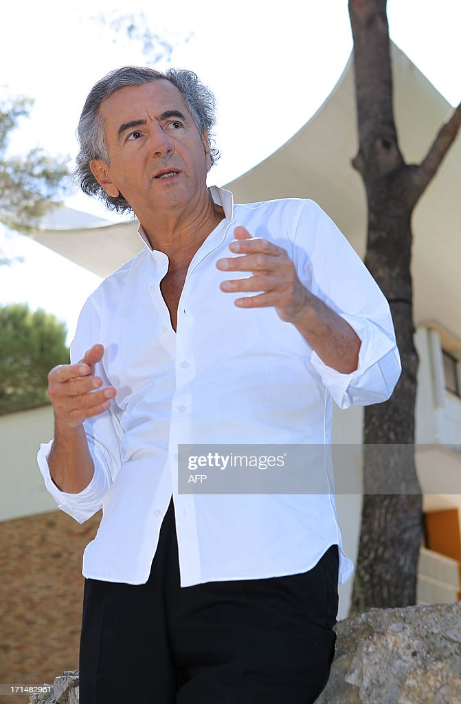 French philosopher and writer Bernard-Henri Levy answers journalists' questions in the Maeght foundation on June 25, 2013, in Saint-Paul de Vence, southeastern France. The Maeght Foundation gives carte blanche to philosopher Bernard-Henri Levy as artistic curator for the exhibition entitled 'Adventures of truth - Painting and philosophy : a narrative', running from June 29 to November 11, 2013. AFP PHOTO / JEAN-CHRISTOPHE MAGNENET