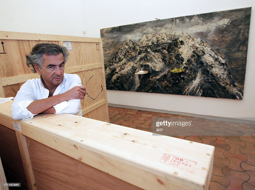 French philosopher and writer Bernard-Henri Levy poses as he prepares an exhibition in the Maeght foundation on June 25, 2013, in Saint-Paul de Vence, southeastern France. The Maeght Foundation gives carte blanche to philosopher Bernard-Henri Levy as artistic curator for the exhibition entitled 'Adventures of truth - Painting and philosophy : a narrative', running from June 29 to November 11, 2013.