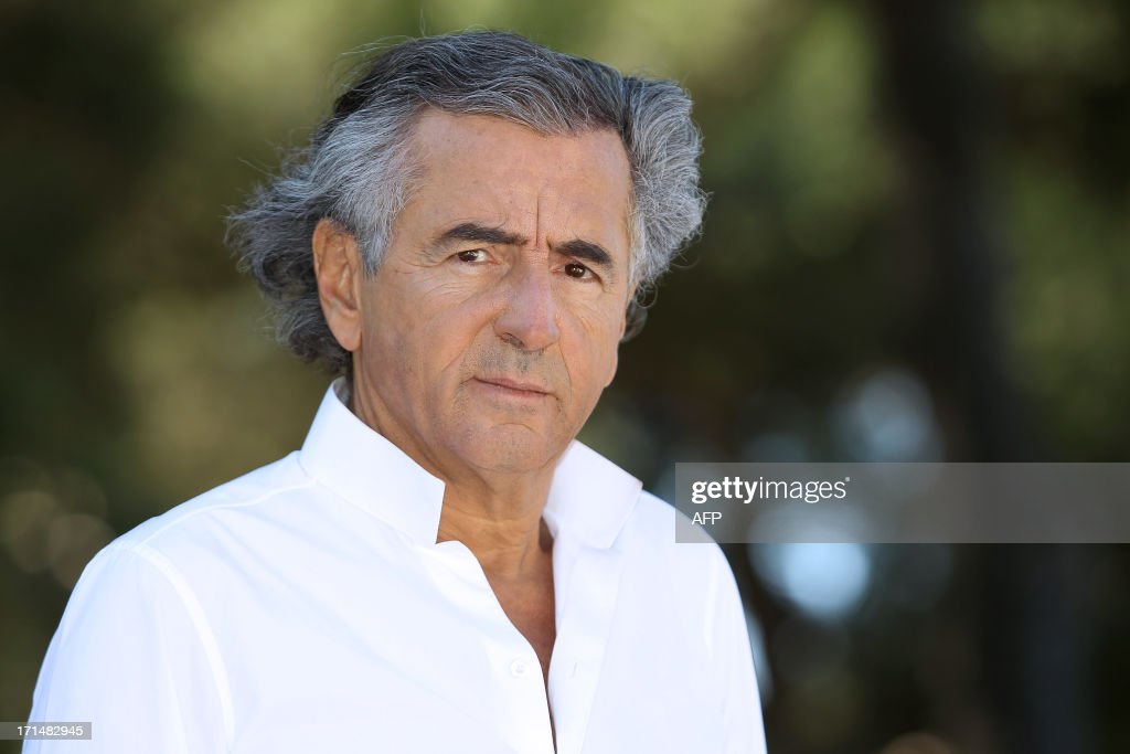 French philosopher and writer Bernard-Henri Levy poses in the Maeght foundation on June 25, 2013, in Saint-Paul de Vence, southeastern France. The Maeght Foundation gives carte blanche to philosopher Bernard-Henri Levy as artistic curator for the exhibition entitled 'Adventures of truth - Painting and philosophy : a narrative', running from June 29 to November 11, 2013. AFP PHOTO / JEAN-CHRISTOPHE MAGNENET