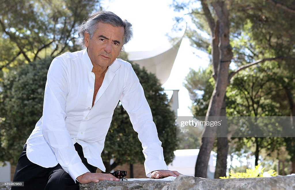French philosopher and writer Bernard-Henri Levy poses in the Maeght foundation on June 25, 2013, in Saint-Paul de Vence, southeastern France. The Maeght Foundation gives carte blanche to philosopher Bernard-Henri Levy as artistic curator for the exhibition entitled 'Adventures of truth - Painting and philosophy : a narrative', running from June 29 to November 11, 2013.