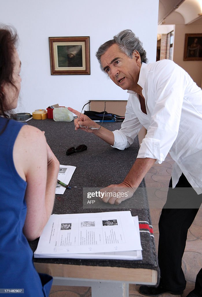 French philosopher and writer Bernard-Henri Levy prepares an exhibition in the Maeght foundation on June 25, 2013, in Saint-Paul de Vence, southeastern France. The Maeght Foundation gives carte blanche to philosopher Bernard-Henri Levy as artistic curator for the exhibition entitled 'Adventures of truth - Painting and philosophy : a narrative', running from June 29 to November 11, 2013.
