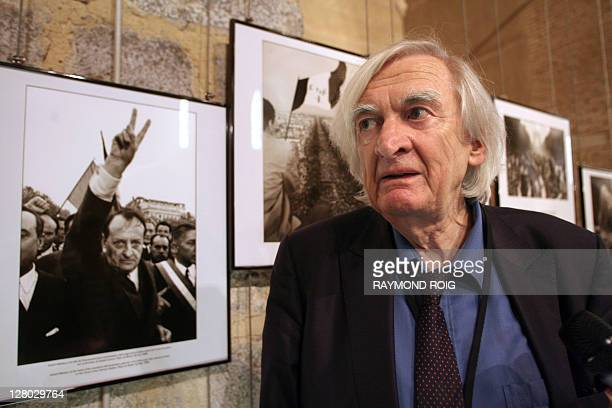French photo agency Sipa's founder and photographer Goksin Sipahioglu poses on September 5 2008 in Perpignan southern France next to his pictures...