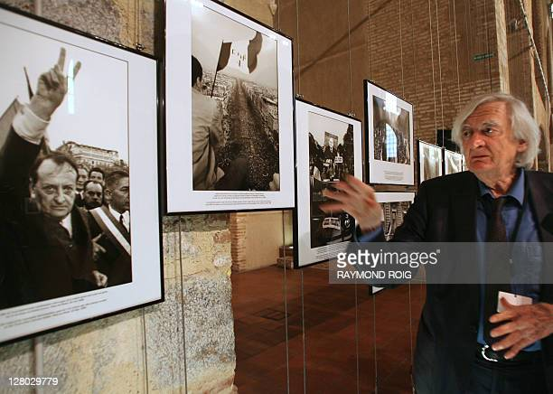 French photo agency Sipa's founder and photographer Goksin Sipahioglu talks on September 5 2008 in Perpignan southern France next to his pictures...