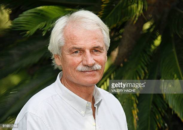 French photographer and film director Yann Arthus Bertrand poses during a photocall for the documentary film '6 Billion Others Testimonies on climate...