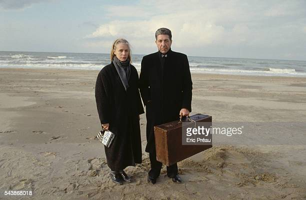 French photographer Dominique Issermann on the beach with the Canadian singersongwriter writer and poet Leonard Cohen during the filming of a music...