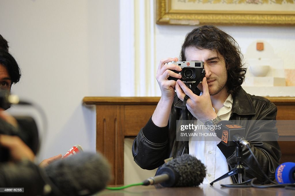 French photographer Edouard Elias who was taken hostage north of the main northern Syrian city of Aleppo on June 6 takes pictures of journalists...