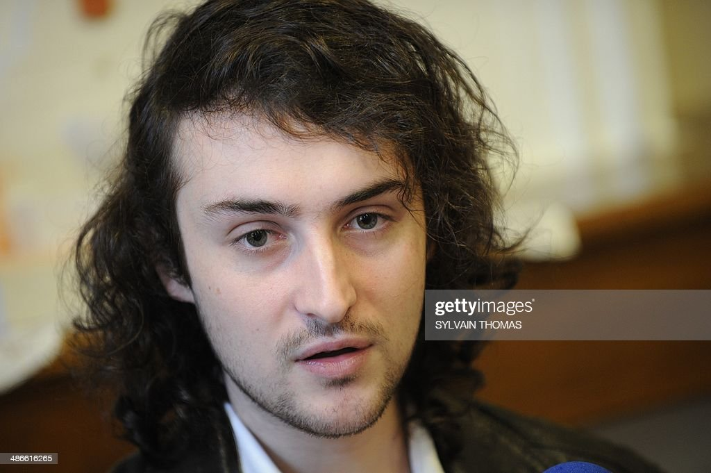 French photographer Edouard Elias who was taken hostage north of the main northern Syrian city of Aleppo on June 6 speaks during a press conference...