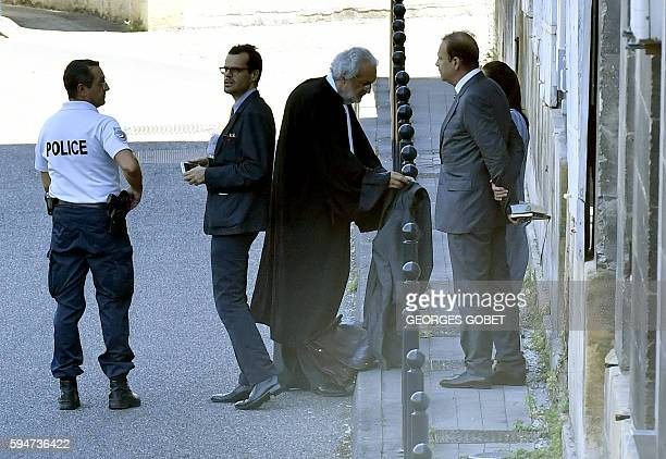 French photographer FrancoisMarie Banier and his companion Martin d'Orgeval leave by a back door after hearing the verdict of the Appeal court of...