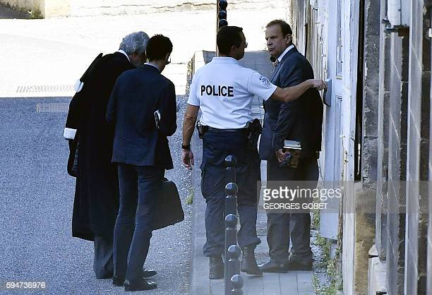 TOPSHOT French photographer FrancoisMarie Banier and his companion Martin d'Orgeval leave by a back door after hearing the verdict of the Appeal...