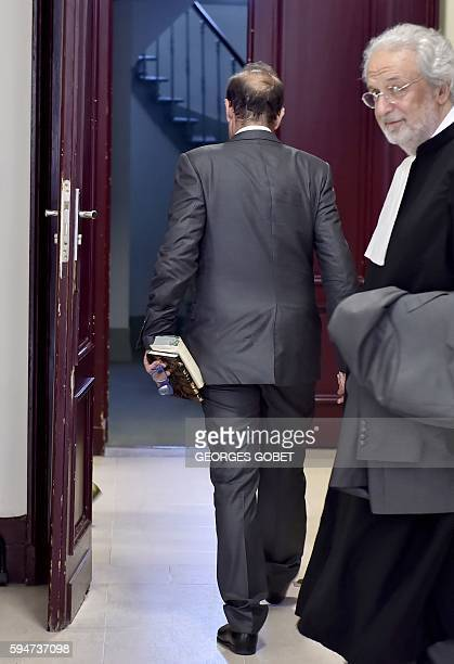French photographer FrancoisMarie Banier leaves after hearing the verdict of the Appeal court of Bordeaux southwestern France on August 24 2016 in...