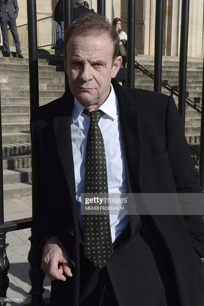 French photographer <a gi-track='captionPersonalityLinkClicked' href=/galleries/search?phrase=Francois-Marie+Banier&family=editorial&specificpeople=6583891 ng-click='$event.stopPropagation()'>Francois-Marie Banier</a> waits in front of the Bordeaux courthouse February 3, 2015 for the 7th day of the trial of ten people charged with exploiting France's richest woman Liliane Bettencourt, L'Oreal heiress. Ten members of Bettencourt's entourage are accused of taking advantage of the 92-year-old billionaire's growing mental fragility in an explosive legal and political drama.