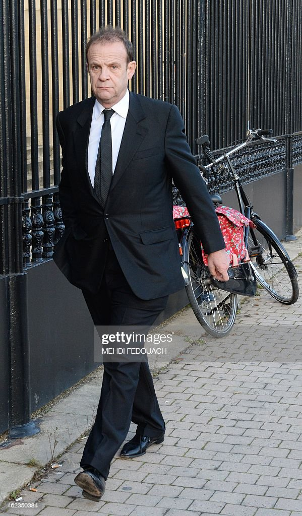 French photographer François-Marie Banier arrives at the Court House in Bordeaux on January 27, 2015, after a break on the second day of the trial of ten people close to L'Oreal heiress French Liliane Bettencourt, France's richest woman. The ten people are charged with exploiting the frail L'Oreal heiress in an explosive drama that began with a family feud and put a president in the court's crosshairs. The trial began with the revelation that one of the accused, a former nurse of Bettencourt, had tried to kill himself on the eve of his appearance.