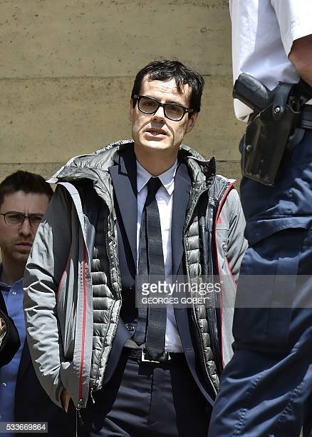 French photographer Martin d'Orgeval leaves the Bordeaux's courthouse on May 23 2016 after morning hearings during his appeal trial for allegedly...