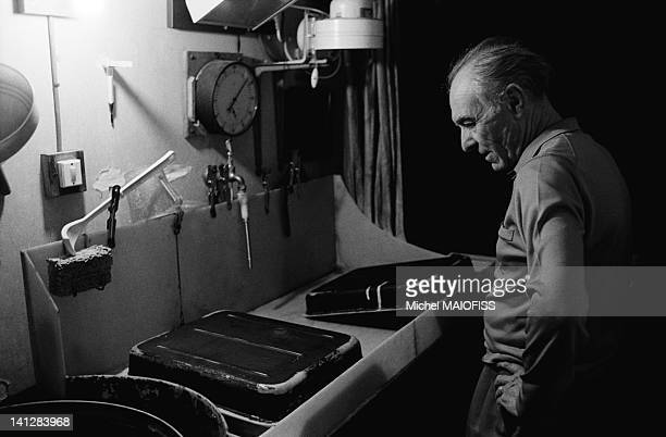 French photographer Robert Doisneau in his photo lab at home on June 18 1988 in Montrouge France