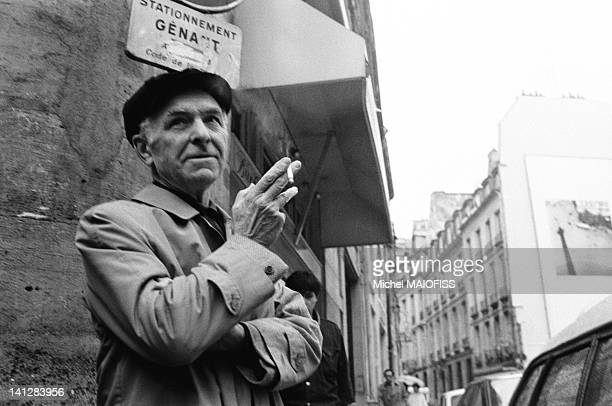 French photographer Robert Doisneau in the Odeon neighborhood with one of his picture on a wall behind him on May 31 1988 in Paris France