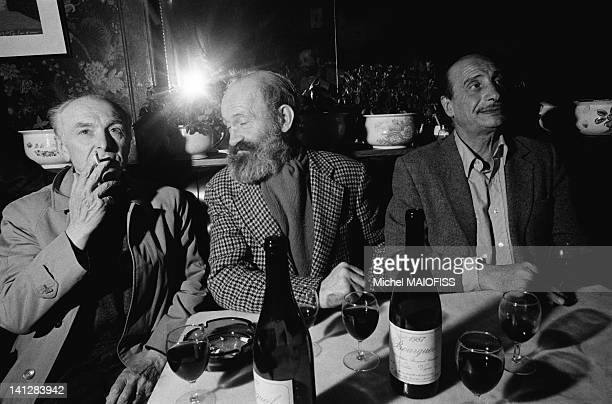French photographer Robert Doisneau with author Antoine Blondin and photographer Edouard Boubat talking about the book 'L'Argot de Bistrot' at cafe...