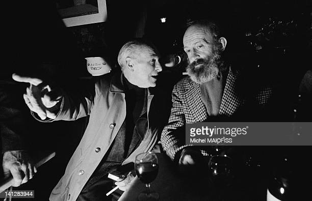 French photographer Robert Doisneau with author Antoine Blondin at cafe Le Cameleon on April 17 1989 in Paris France