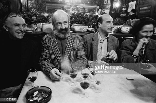 French photographer Robert Doisneau with author Antoine Blondin photographer Edouard Boubat and Yvette Troispoux for the book 'L'Argot de Bistrot' on...