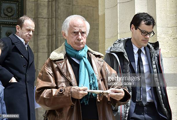 French photographers FrancoisMarie Banier and Martin d'Orgeval leave the Bordeaux's courthouse on May 23 2016 after morning hearings during their...