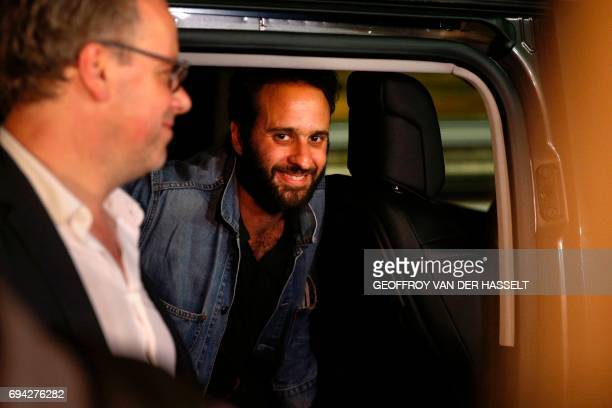 French photojournalist Mathias Depardon and head of French media watchdog Reporters Without Borders Christophe Deloire get into a van after Depardon...