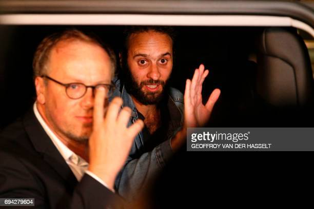 French photojournalist Mathias Depardon and head of French media watchdog Reporters Without Borders Christophe Deloire wave as they get into a van...