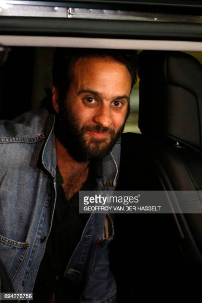 French photojournalist Mathias Depardon gets into a van after he landed from Istanbul at RoissyCharlesdeGaulle aiport north of Paris on June 9 2017...