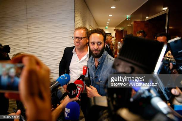 French photojournalist Mathias Depardon next to head of French media watchdog Reporters Without Borders Christophe Deloire addresses the media after...