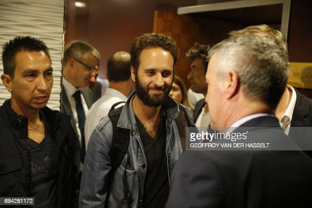 French photojournalist Mathias Depardon speaks with French president's chief of staff Patrick Strzoda after Depardon landed from Istanbul at...