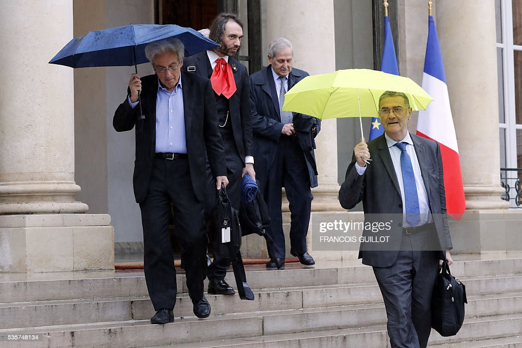 French physicist Albert Fert, French mathematician Cedric Villani, French physicist Claude Cohen-Tannoudji and French physicist Serge Haroche leave the Elysee palace in Paris following a meeting with the French President on May 30, 2016 following an article, signed by seven Nobel Prize winners and one Fields medal winner, published in the French newspaper Le Monde regarding the draft decree of budget cuts in research and higher education. French President Francois Hollande has removed credit cuts of 134 millions of euros from the budget of the research, said Nobel Prize winner Serge Haroche after having been received at the Elysee Palace with five other leading scientists.