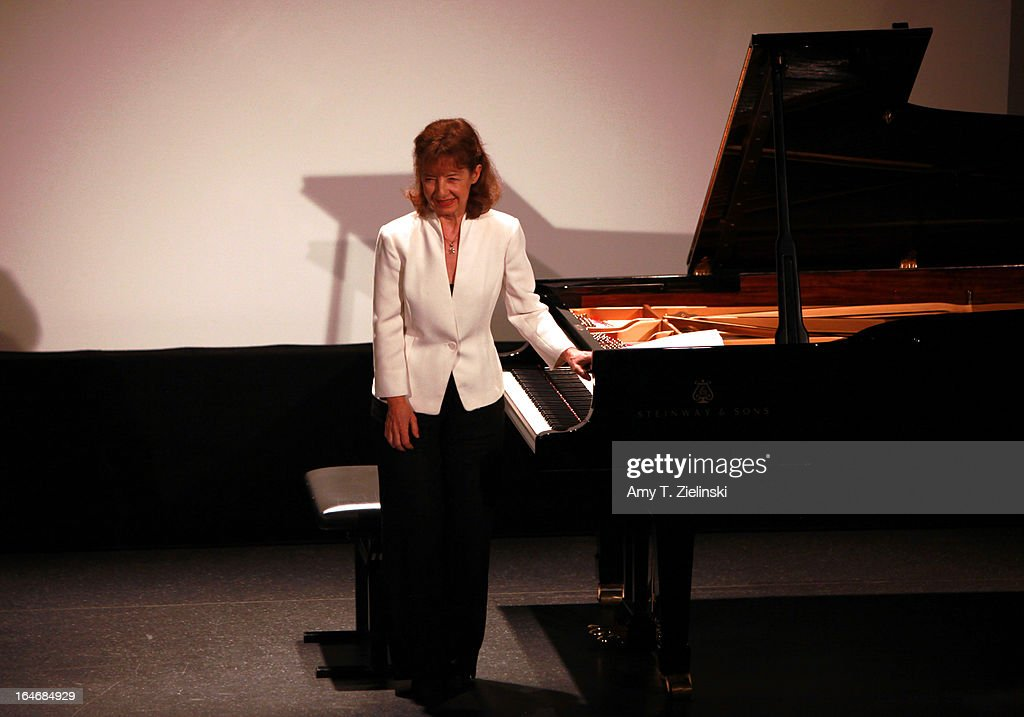 French Pianist Anne Queffelec acknowledges the audience after performing works by composers Poulenc, Debussy, de Severac, Dupont and other contemporaries of Erik Satie at a Steinway grand piano on stage in Cine Lumiere during 'It's All About Piano!' festival inside the The Institut Francais on March 24, 2013 in London, England. The festival is a collaboration from French Music Office to celebrate the piano with recitals from classical to jazz, film screenings, children's activities, workshops and cinema screenings exploring the musical instrument.