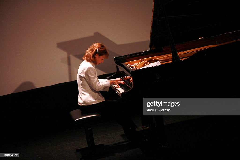 French Pianist Anne Queffelec performs works by composers Poulenc, Debussy, de Severac, Dupont and other contemporaries of Erik Satie at a Steinway grand piano on stage in Cine Lumiere during 'It's All About Piano!' festival inside the The Institut Francais on March 24, 2013 in London, England. The festival is a collaboration from French Music Office to celebrate the piano with recitals from classical to jazz, film screenings, children's activities, workshops and cinema screenings exploring the musical instrument.
