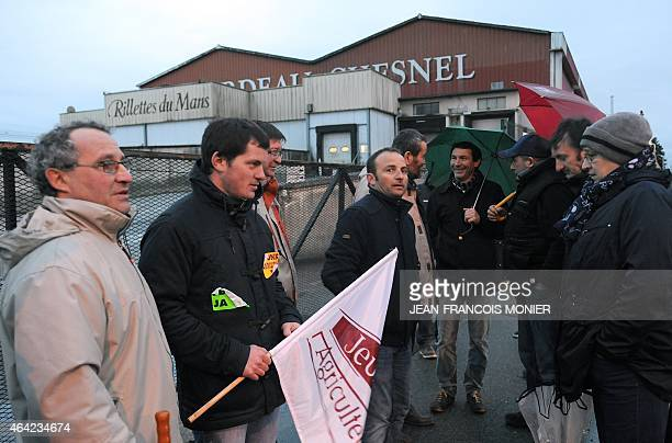 French pig farmers block the entrance to the 'Rillettes' Luissier Bordeau Chesnel plant in Champagne near Le Mans western France on February 23 2015...