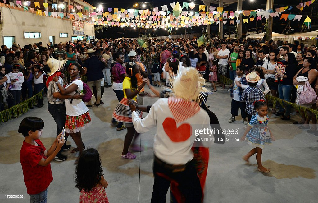 French pilgrims dance Brazilian typical music during a party organized by the Brazilian Catholic Church in Sao Goncalo municipality, 30 km from Rio de Janeiro, Brazil on July 17, 2013. The Brazilian Catholic Church confirmed the attendance of over 300 thousand foreign pilgrims for the World Youth Day (WYD) to be held in Rio next July 22 to 28 with the presence of Pope Francis.