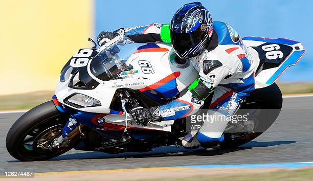 French pilot Hugo Marchand rides his BMW N° 99 and clocked the best lap time in 1'37545 during the warmup of the 34th Le Mans 24hour endurance race...