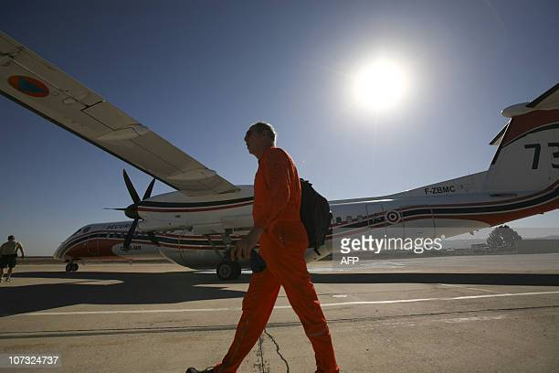 A French pilot of a Dash 8 waterbomber plane stand on the tarmac at Ramat David air base in Israel on December 4 2010 upon arrival from France in...